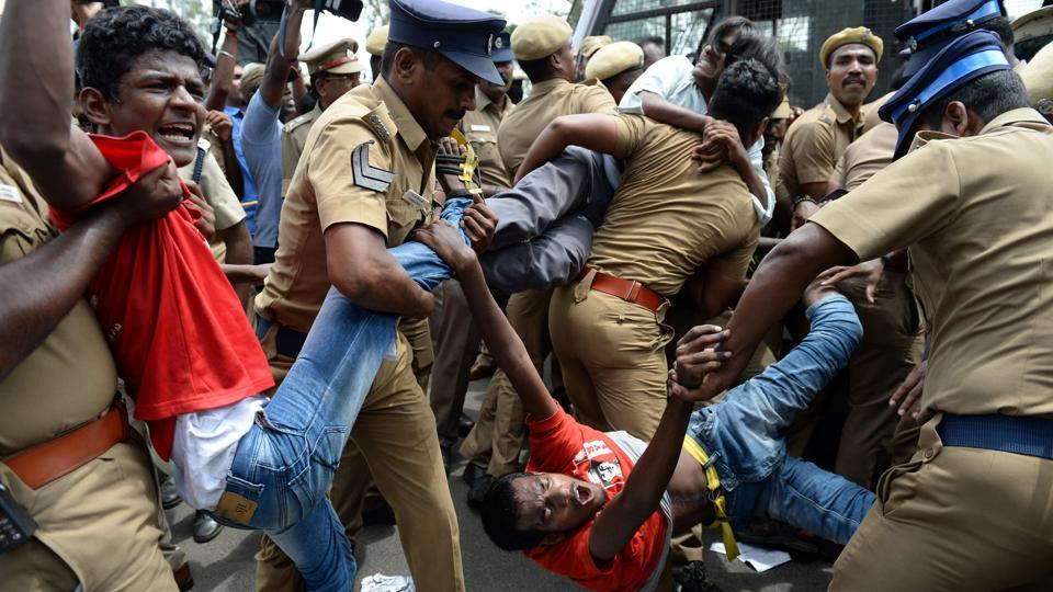 Police remove members of RSYF in Chennai, protesting against Prime Minister Narendra Modi and the Centre's ban on the sale of cows for slaughter through animal markets.