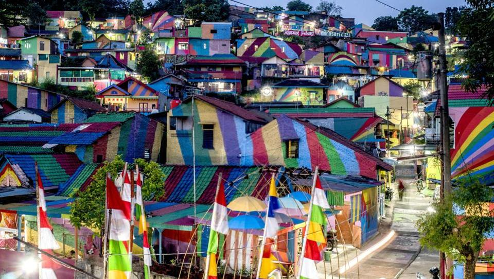 An Indonesian hamlet dubbed 'the rainbow village' after being given a makeover in a kaleidoscope of colours is attracting hordes of visitors and has become an Internet sensation. (SURYO WIBOWO / AFP)