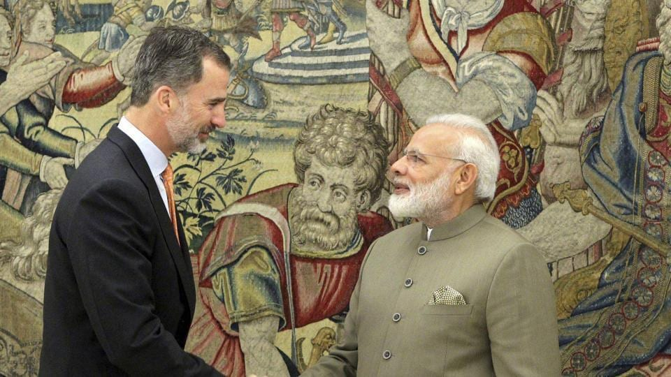 Prime Minister Narendra Modi (R) shakes hands with Spain's King Felipe VI at the Zarzuela Palace in Madrid, Spain on Wednesday.