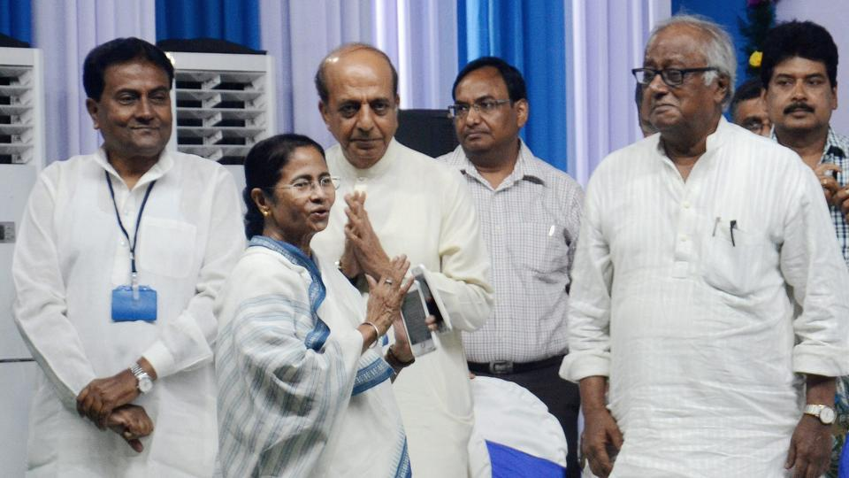 West Bengal chief minister Mamata Banerjee with MPs Dinesh Trivedi and Saugata Ray during 'North 24 Parganas district's administrate meeting' in Barrackpore on Tuesday.
