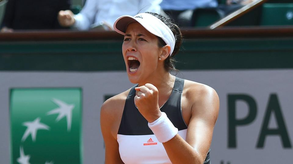 Defending champion Garbine Muguruza was given a run for her money by Estonia's Anett Kontaveit in their second round clash, but the Spaniard eventually prevailed. (AFP)
