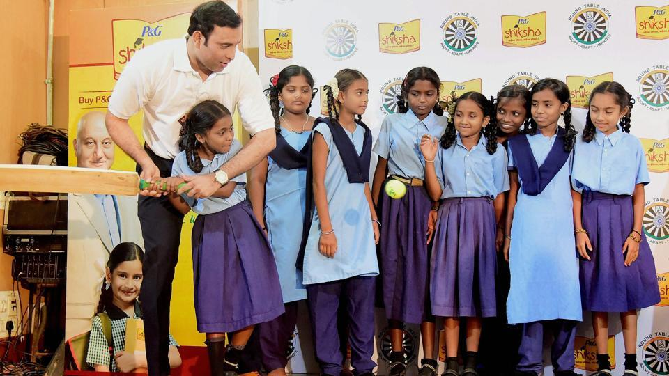 Former India cricketer VVS Laxman with school kids during an event for the education of the under privileged in Bangalore on Wednesday.