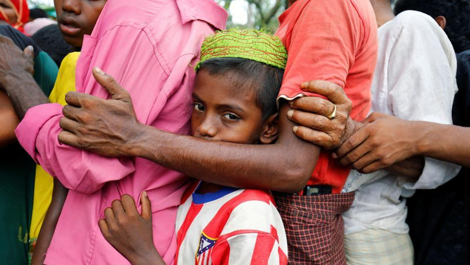 A Rohingya refugee boy stands in a queue to collect relief supplies. Following the recent influx,the Bangladeshi government has estimated that  there are about 350,000 Rohingyas in the country.  (Mohammad Ponir Hossain/REUTERS)