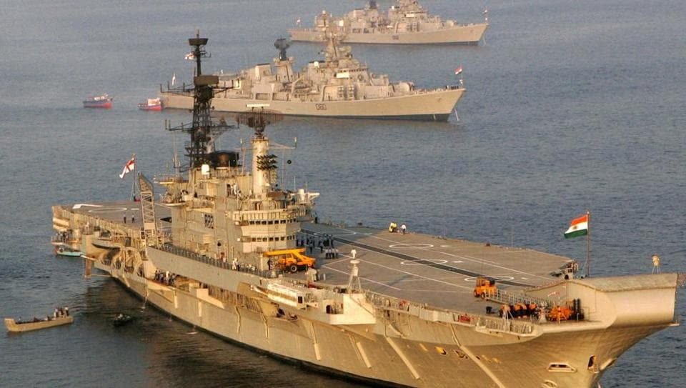 The Indian Navy's aircraft carrier Viraat anchored alongside other ships ahead of a fleet review in Visakhapatnam in February 2006.
