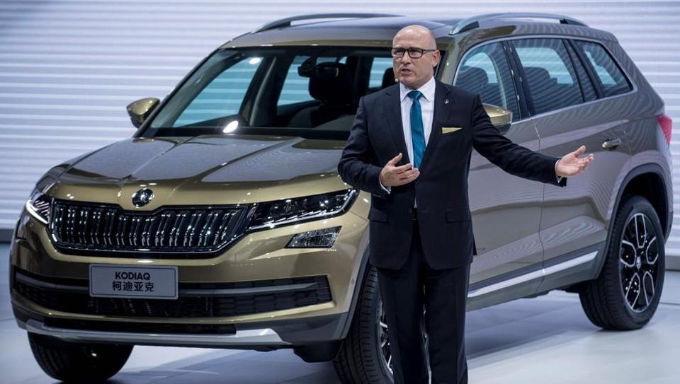 CEO of carmaker Skoda, Bernhard Maier speaks next to a Skoda Kodiaq during the media day of the 17th Shanghai International Automobile Industry Exhibition in Shanghai. The Kodiaq will come to India sometime later this year.