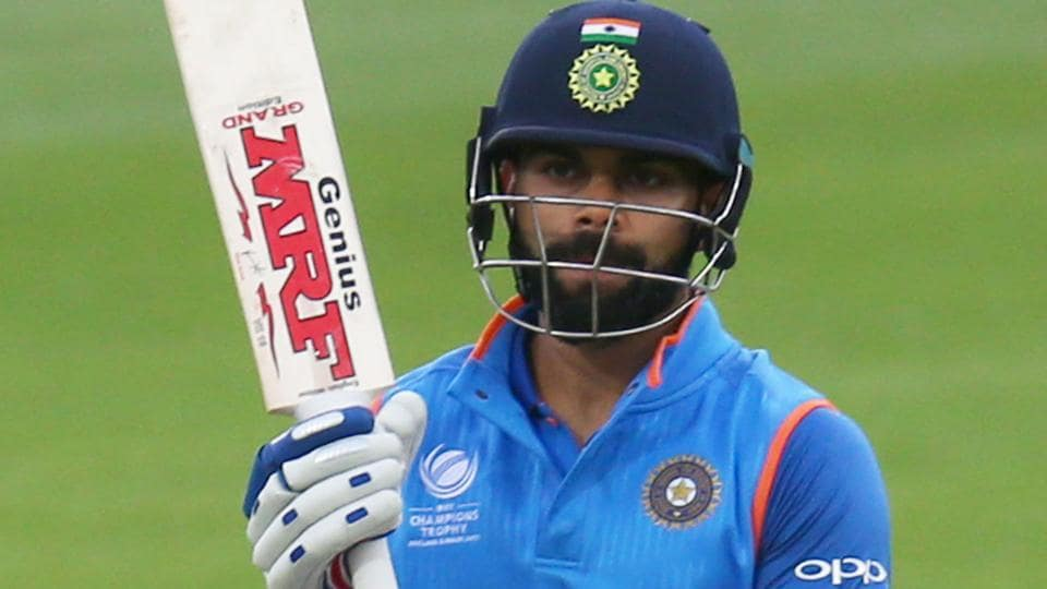India's captain Virat Kohli celebrates his half century during the ICC Champions Trophy warm-up match against New Zealand.