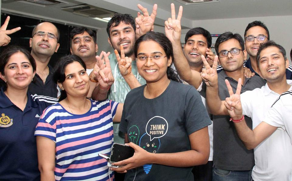 Karnataka's Nandini K R (centre), who stood first in the civil services exams 2016, celebrates with her colleagues in Faridabad on Wednesday.
