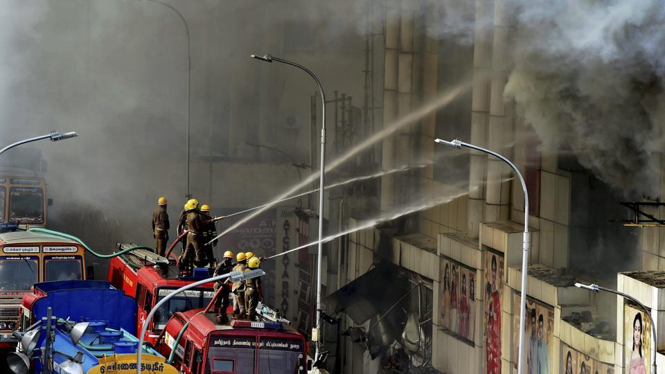Fire personnel dousing the massive fire that broke out at Chennai Silks in T Nagar on Wednesday.