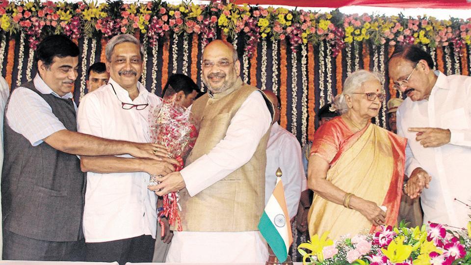 BJP President Amit Shah greeting Goa CM Manohar Parrikar during the swearing in ceremony on March 14, 2017. (L to R) Ramakrishna Dhavlikar, Union Minister Nitin Gadkari, Venkaiah Naidu, Governor Mridula Sinha are also seen.