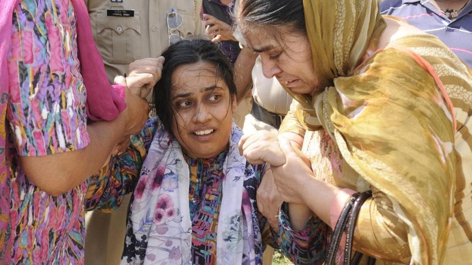 The grieving kin of Rajatvir Singh who, the police claimed, had killed himself as cops raided his house to probe terror links, in Patiala on Thursday, June 1.