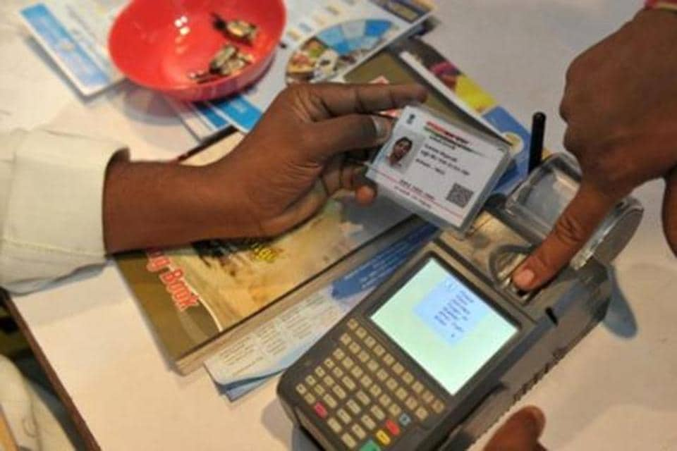 An Indian visitor gives a thumb impression to withdraw money from his bank account with his Aadhaar or Unique Identification (UID) card during a Digi Dhan Mela.
