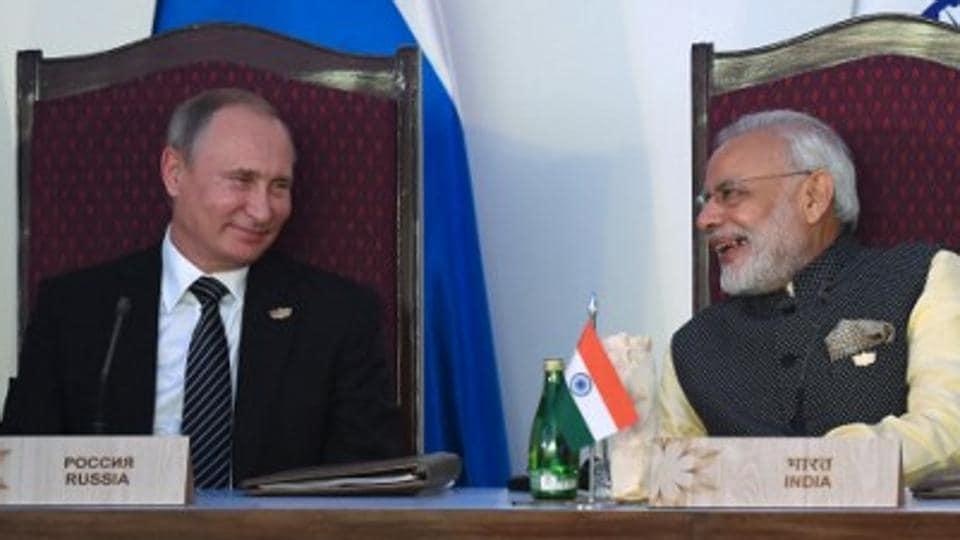 PMModi (right) with Russian President Vladimir Putin during the BRICS summit in Goa.