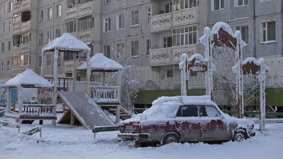 A car covered in ice is pictured near a playground . (Maxim Shemetov / REUTERS)