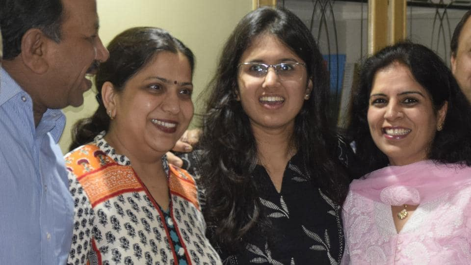 Navya Singla with her family at their Sector-8 residence in Panchkula on Wednesday.