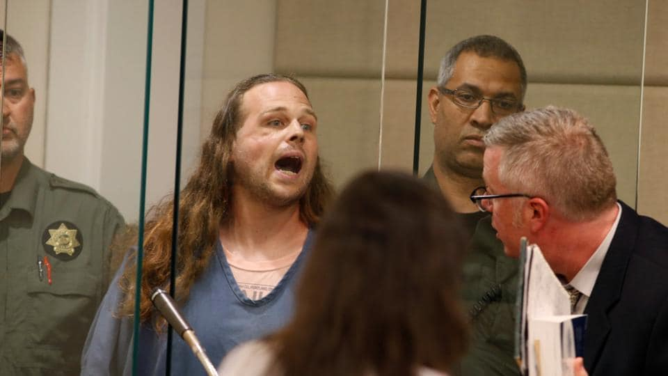 Jeremy Christian, accused of fatally stabbing two Good Samaritans who tried to stop Christian from harassing a pair of women who appeared to be Muslim, shouts during an appearance in Multnomah County Circuit Court in Portland, Oregon, US, May 30, 2017