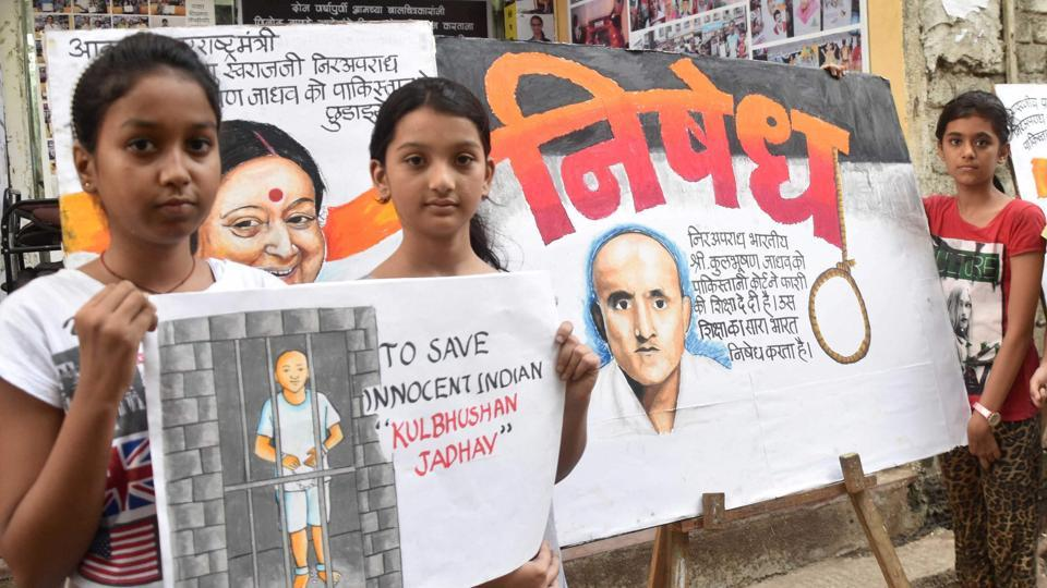 School girls in Mumbai show placards asking for the release of former Indian naval officer Kulbhushan Jadhav.
