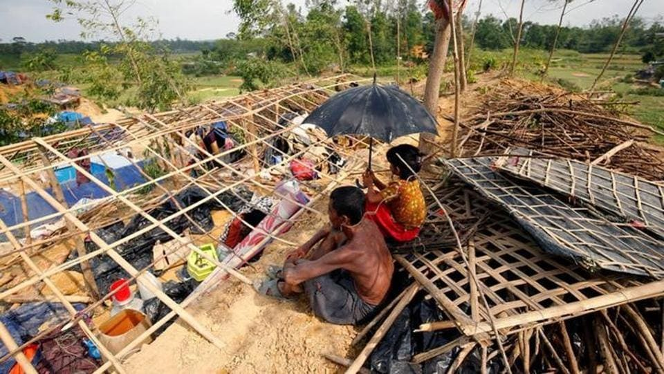 Rohingya refugees sit in front of their house destroyed by Cyclone Mora at the Balukhali Makeshift Refugee Camp in Cox's Bazar, Bangladesh. Left drenched and near destitute by a cyclone that hit Bangladesh few days ago, thousands of Rohingya refugees hunkered down in the ruins of their camps , waiting for help after a night in the rain. According to administrative officials at least seven people were killed and 50 injured by Cyclone Mora, affecting over a quarter million people in the country.  (Mohammad Ponir Hossain/REUTERS)