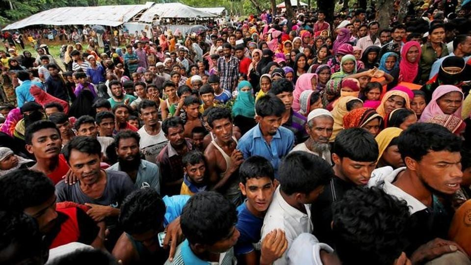 With power supplies knocked out and fresh food in short supply, aid agencies handed out rations to refugees who thronged distribution points. (Mohammad Ponir Hossain/REUTERS)