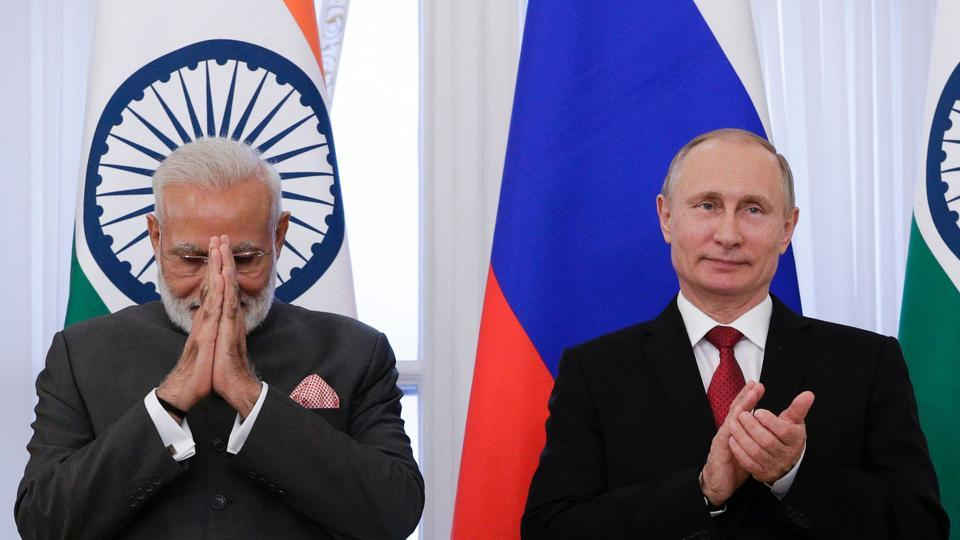 Russian President Vladimir Putin and Prime Minister Narendra Modi attend a signing ceremony following their meeting on the sidelines of the St. Petersburg International Economic Forum (SPIEF) in Saint Petersburg on June 1.