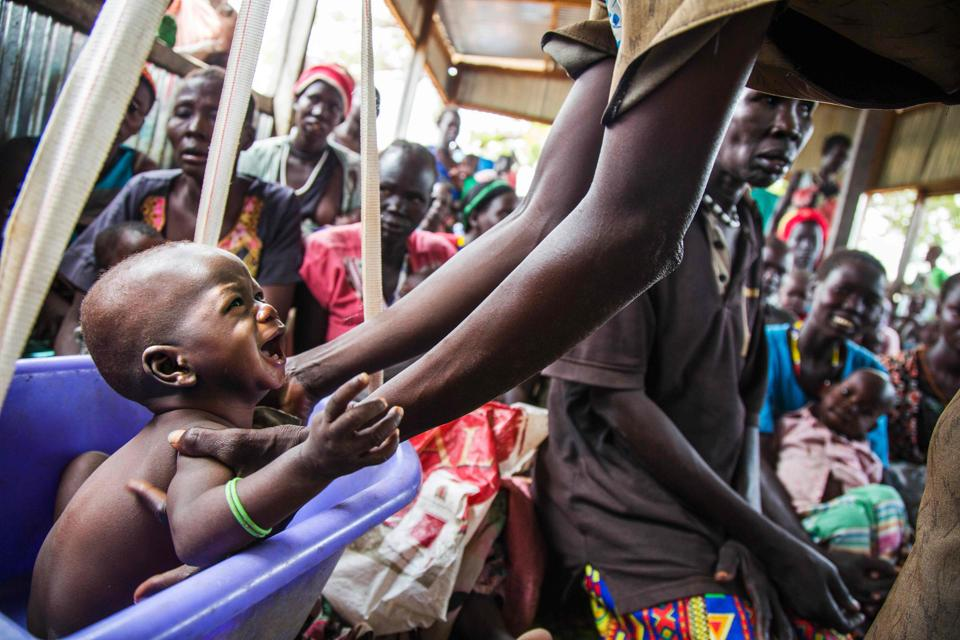A mother weights her malnourished child in a nutrition centre run by the International Rescue Committee (IRC) in Panthau, Northern Bahr al Ghazal, South Sudan. (Albert Gonzalez Farran / AFP)