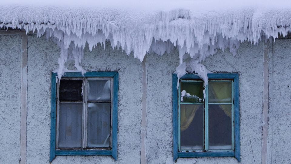 The roof of a house is covered with snow in the village of Tomtor. And despite its terrible winters, in June, July and August temperatures over 30c are not uncommon. (Maxim Shemetov / REUTERS)
