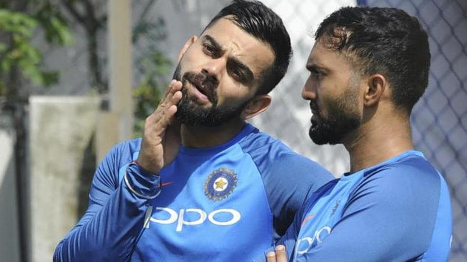 Virat Kohli in discussion with Dinesh Karthik (R) during the practice session. (AP)