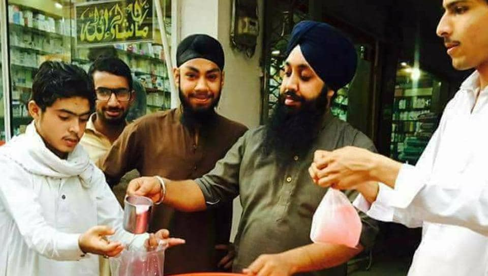 Sikh businessman Sahib Singh has set up a stall outside his medicine shop inPeshawar to dole out sweet-drinks, 'lassi' and food to fasting Muslims.