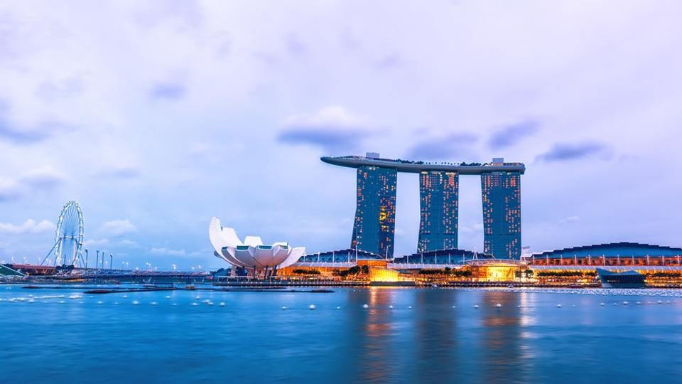 Evening landscape with Museum of Fine Arts and Marina Bay Sands Hotel, Singapore.
