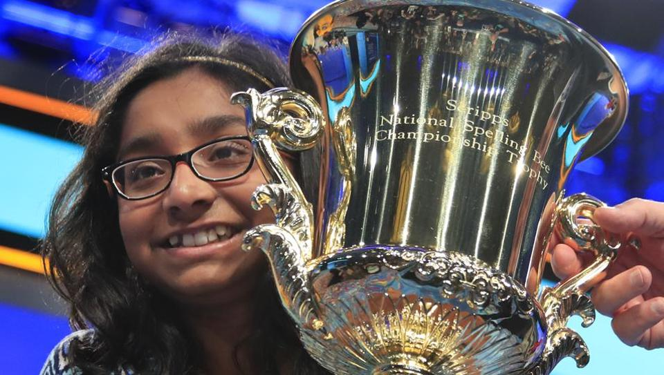 Ananya Vinay, 12, from Fresno, California, holds the trophy after being declared the winner of the 90th Scripps National Spelling Bee, in Oxon Hill.