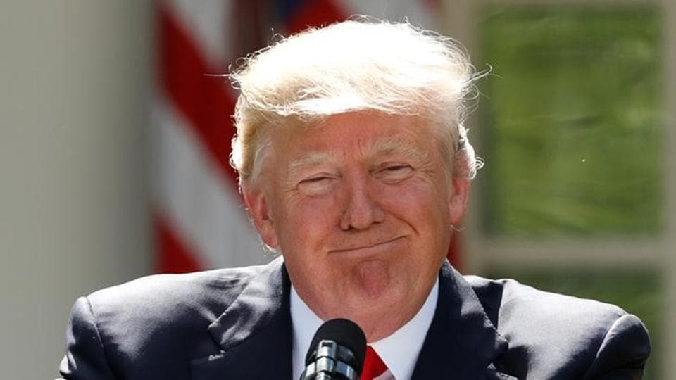 US President Donald Trump pauses as he announces his decision that the United States will withdraw from the landmark Paris Climate Agreement, in the Rose Garden of the White House in Washington.