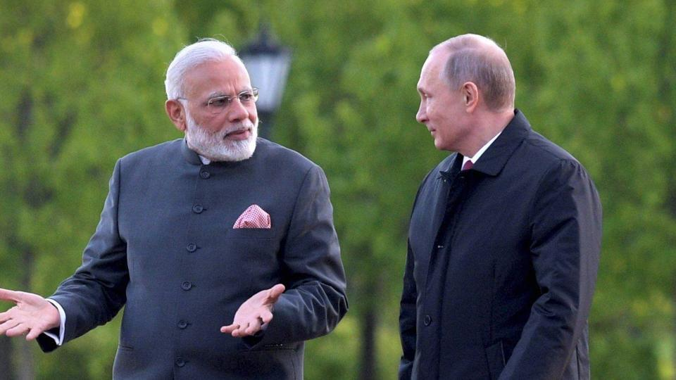 Prime Minister Narendra Modi and Russian President Vladimir Putin talk to each other as they walk near the Constantine (Konstantinovsky) Palace at the St. Petersburg International Economic Forum in St. Petersburg, Russia.