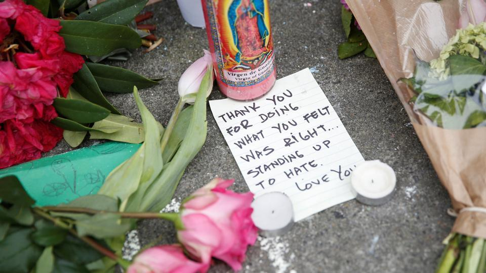 A note rests at a makeshift memorial for the two men who were killed May 26 on a commuter train while trying to stop another man from harassing two young women who appeared to be Muslim, in Portland, Oregon.