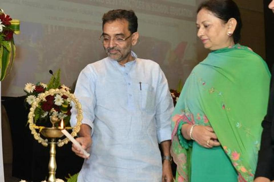 Union minister of state for human resource development Upendra Kushwaha lighting the ceremonial lamp along with Punjab education minister Aruna Chaudhary during a conference in Chandigarh on Thursday.
