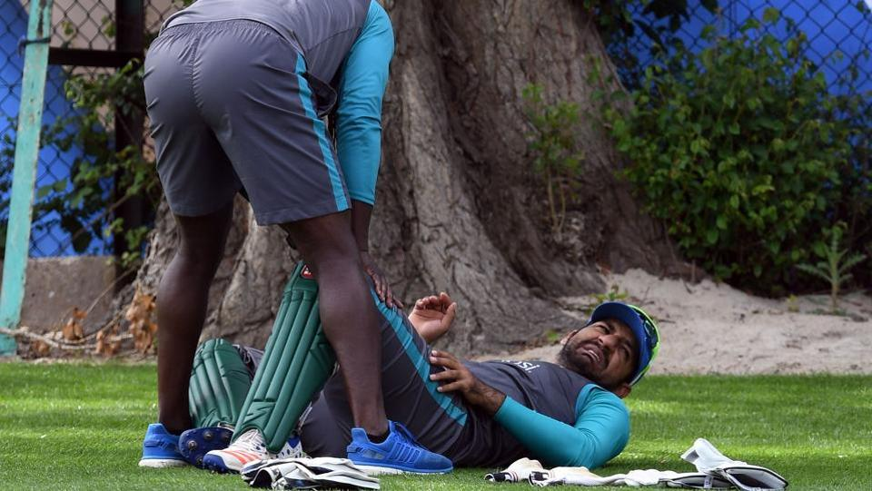Pakistan's Sarfraz Ahmed (R) gets attention on the floor during a nets practice session. (AFP)