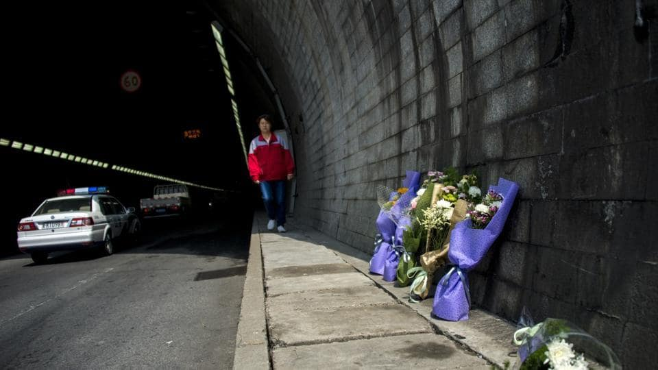 This May 10, 2017 file photo shows flowers at the entrance of the Taojiakuang tunnel, the scene of a bus accident that killed 11 South Korean and Chinese kindergarteners and their driver, in the city of Weihai in Shandong province. A bus fire that killed 11 kindergarteners in eastern China last month was intentionally set by their disgruntled driver, who was angry at losing overtime wages.