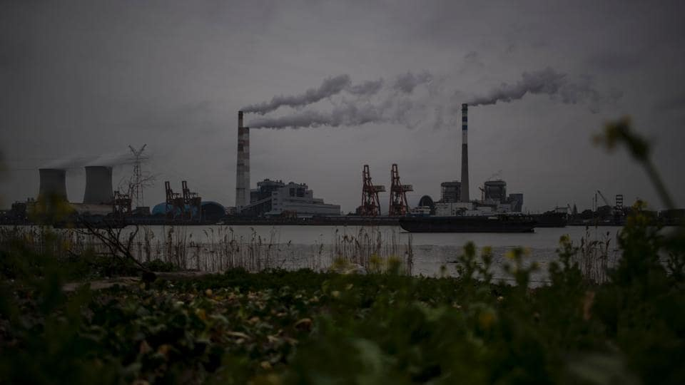 This file photo taken on February 21, 2017 shows the Huangpu river and the Wujing Coal-Electricity Power Station in Shanghai. Beijing vowed on June 2, 2017 to uphold the Paris climate accord after the United States withdrew from the pact, saying it was a