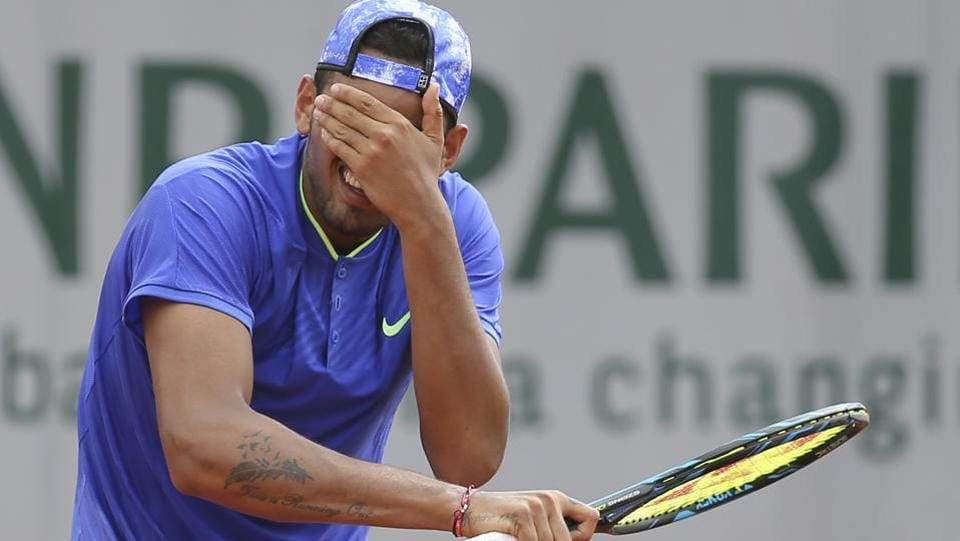 Australia's Nick Kyrgios was dumped out of the tournament by South Africa's Kevin Anderson in their second round match. (AP)