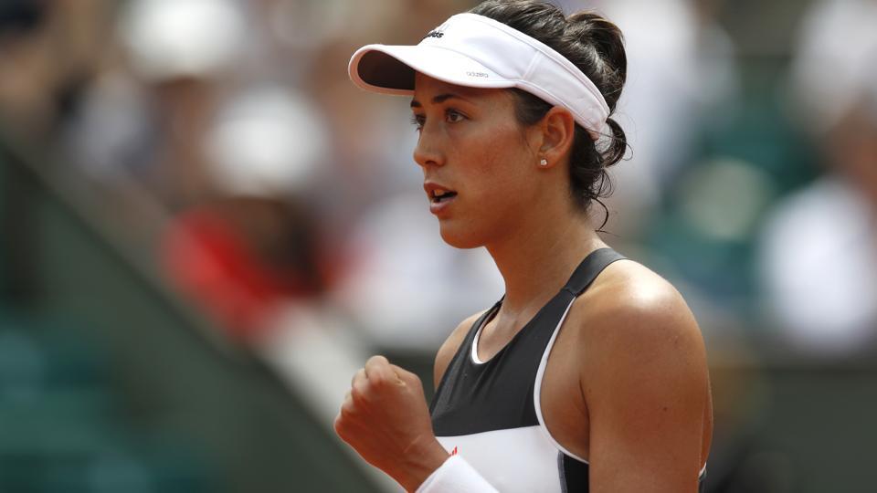 Spain's Garbine Muguruza celebrates her win over Kazakhstan's Yulia Putintseva at the French Open.