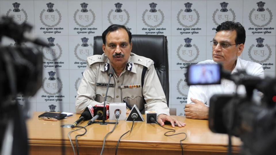Haryana DGP Baljit S Sandhu addresses a press conference at the commissioner's office in Gurgaon on Friday.