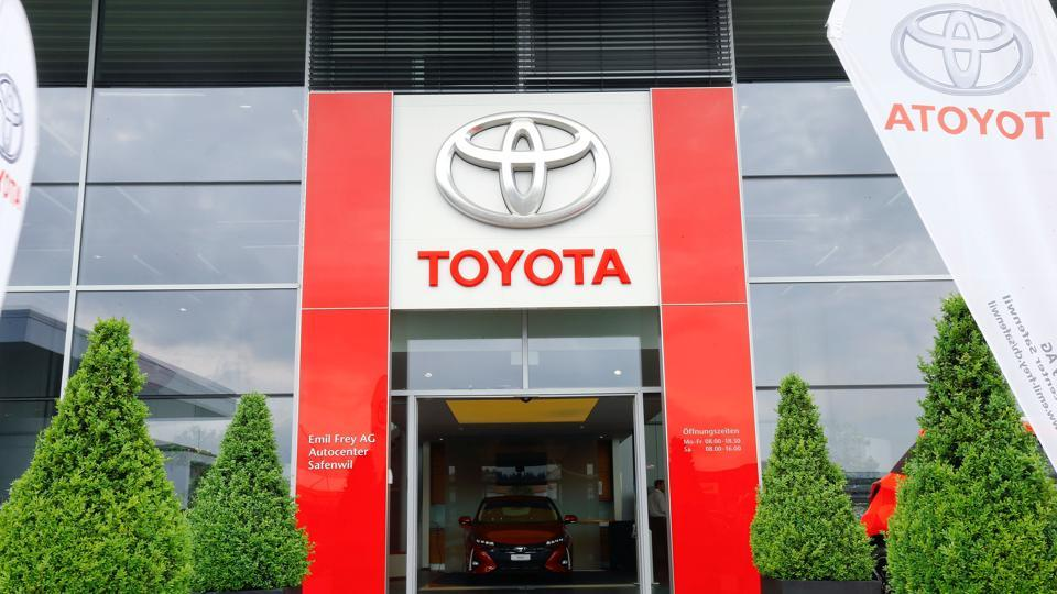 The logo of Japanese car manufacturer Toyota is seen above the entrance of a showroom of Swiss Emil Frey AG in Safenwil, Switzerland.