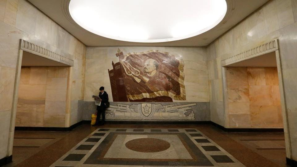 A man reads a newspaper at Baumanskaya metro station in Moscow. One of the busiest and most visually stunning underground systems in the world,it is a tourist site in its own right.When it opened in 1935, the metro had just 11 stations and attracted 285,000 curious riders on the first day. Today there are 206 stations and up to nine million passengers a day. The metro has been expanding fast in the last few years, and modernising with one eye on the World Cup that Russia will host in 2018. (REUTERS)