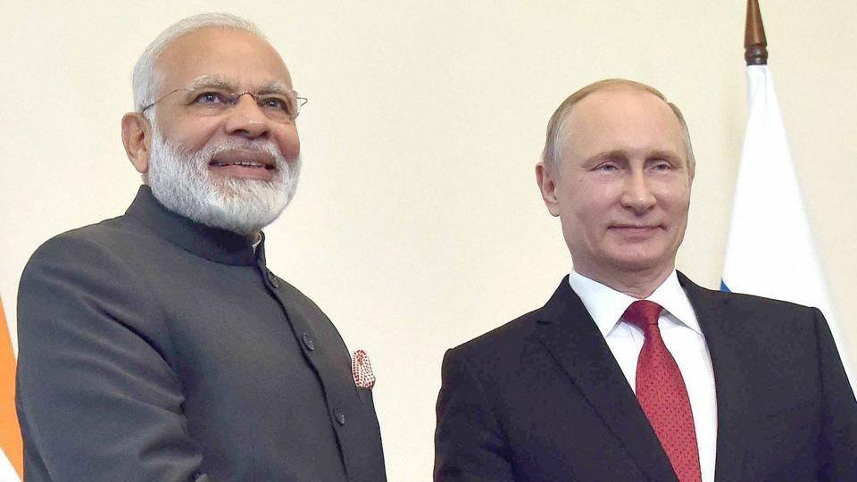 Prime Minister Narendra Modi shakes hands with Russian President Vladimir Putin, at the 18th India Russia Annual Summit, at Konstantin Palace, in St. Petersburg, Russia on Thursday.