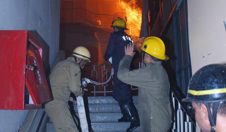 Delhi firemen trying to douse flames at National Museum of Natural History at Mandi House in April 2016.