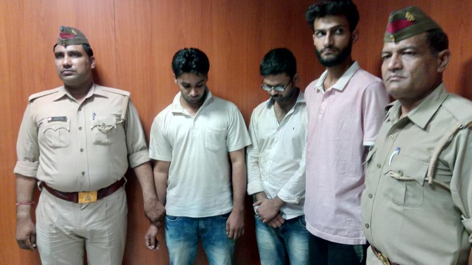 The three men in police custody on Friday.