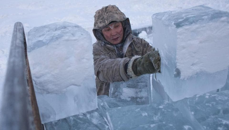 Ruslan, 35, loads blocks of ice onto a truck outside Yakutsk in the Republic of Sakha, northeast Russia. Known as the 'Pole of Cold', the coldest temperatures in the northern hemisphere is considered to be the coldest permanently inhabited settlement in the world. (Maxim Shemetov  / REUTERS)