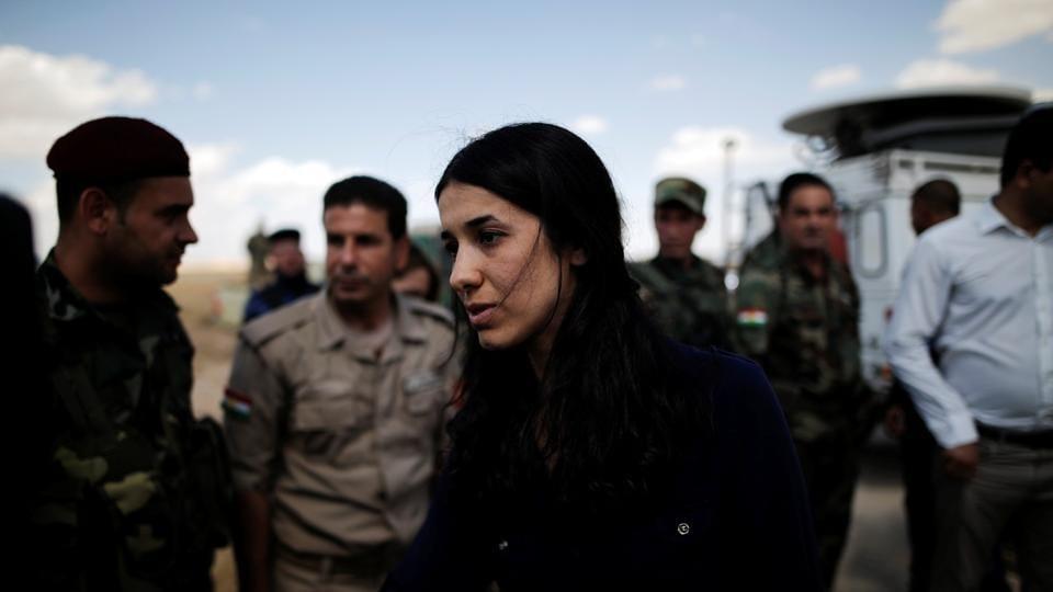 Yazidi survivor and United Nations Goodwill Ambassador for the Dignity of Survivors of Human trafficking, Nadia Murad, greets Kurdish Peshmerga fighters at a defensive point near Sinjar, Iraq June 1, 2017. REUTERS/Alkis Konstantinidis