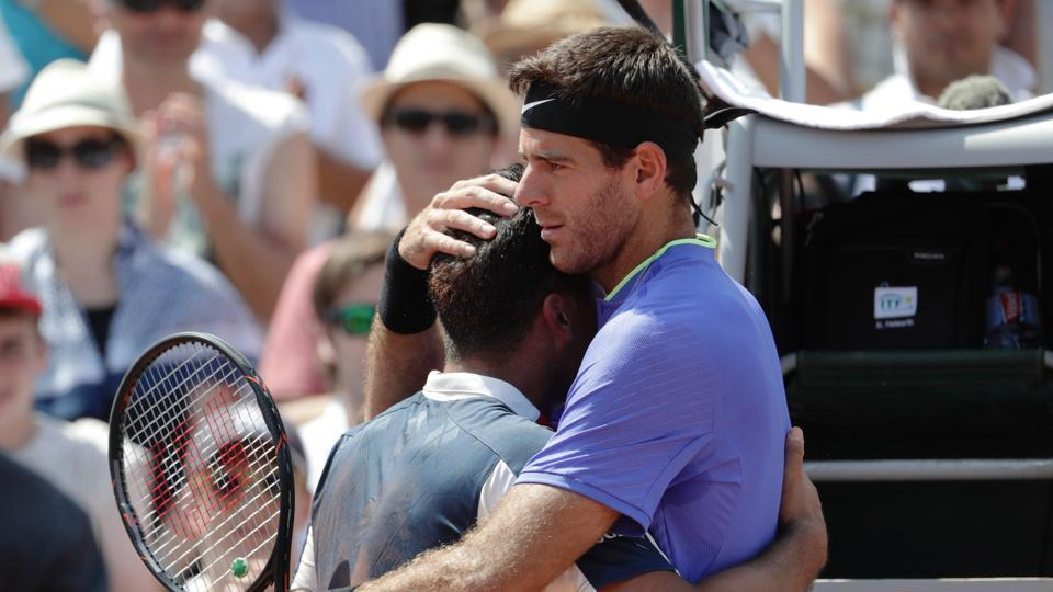 Spain's Nicolas Almagro (L) is comforted by Argentina's Juan Martin Del Potro after being forced to retire in their 2nd round match. Del Potro will next face Murray. (AFP)