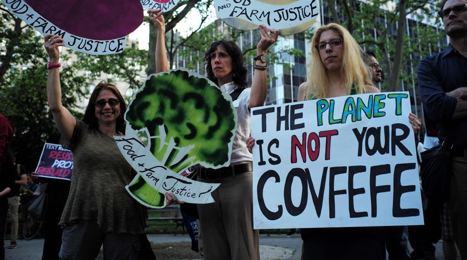 Environmental activists and supporters display placards during a demonstration in New York, to protest US President Donald Trump's decision to pull out of the 195-nation Paris climate accord deal.