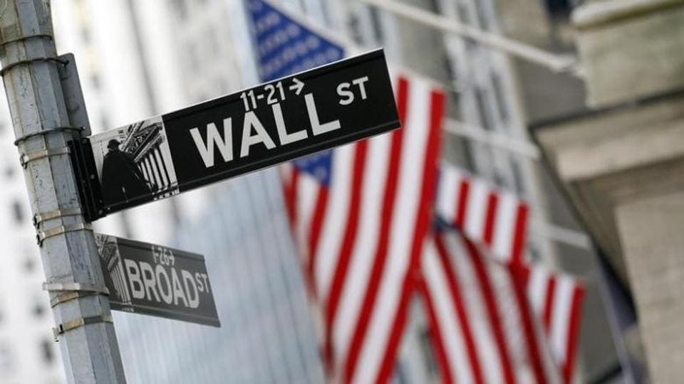 A Wall St. sign is seen outside the New York Stock Exchange.