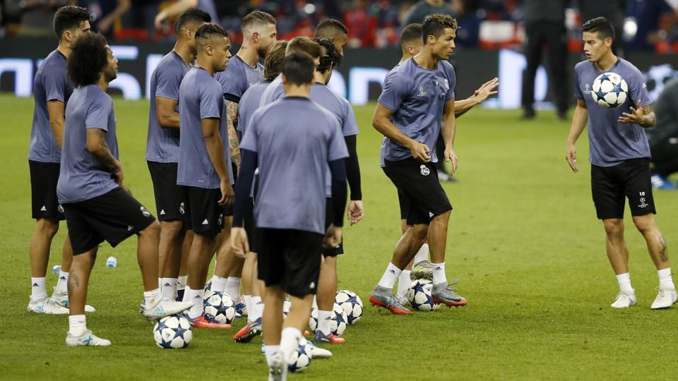 Real Madrid's James Rodriguez, right, holds the ball during a training session at the Millennium Stadium in Cardiff, Wales Friday June 2, 2017. Real Madrid will play Juventus in the final of the Champions League on Saturday.